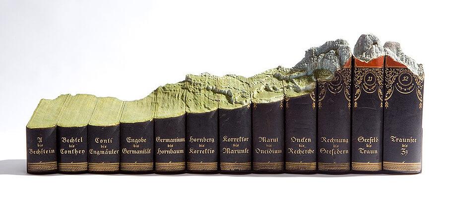 古書に自然風景を彫刻するアーティストGUY LARAMEEの世界観